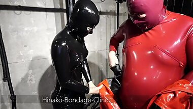 Big Latex Man Struggles to Put on MD Latex Suit
