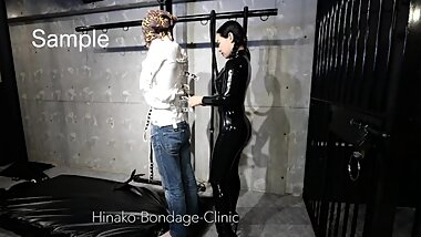Stoic Man in PVC Straitjacket Gets Vibed Sample